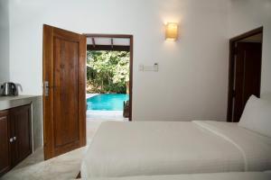 A bed or beds in a room at Pinthaliya Resort & Spa