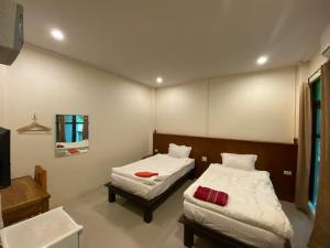 A bed or beds in a room at Jitra Resort