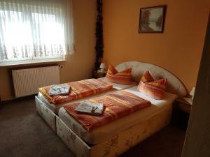 Ein Bett oder Betten in einem Zimmer der Unterkunft Hotel Arkona