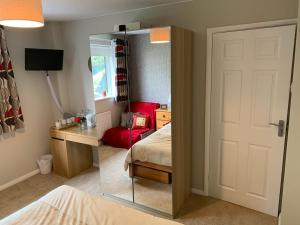 A bed or beds in a room at Chillingham Way