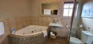 Ванная комната в The Mandyville Jeffreys Bay