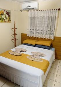 Cama ou camas em um quarto em Residencial Tapajós