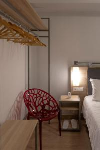 A bed or beds in a room at Pan Hotel
