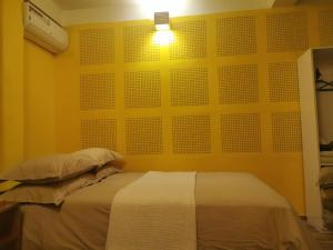 A bed or beds in a room at Gusto Accommodation
