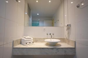Um banheiro em Hotel Dunamys