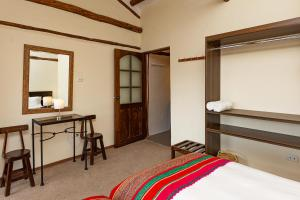 A bed or beds in a room at Luna House Cusco