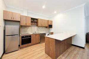 A kitchen or kitchenette at Parklands Resort & Conference Centre