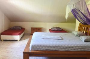 Cama ou camas em um quarto em Fare Om