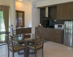 A kitchen or kitchenette at Banyu Biru Villa