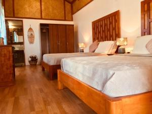 A bed or beds in a room at Balili Villas Resort