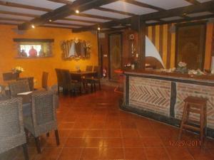 Un restaurante o sitio para comer en Posada Rumoroso