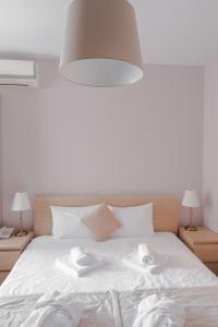 Кровать или кровати в номере Ломоносов