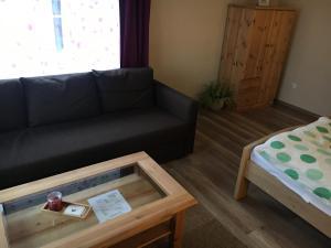 Ein Sitzbereich in der Unterkunft Pension am Silberberg