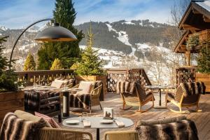 A restaurant or other place to eat at Les Chalets du Mont d'Arbois Megeve, a Four Seasons Hotel