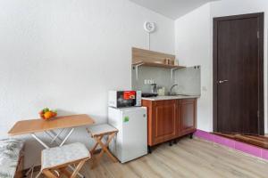 A kitchen or kitchenette at Katuar Life Apartments