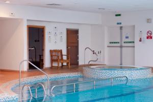 The swimming pool at or near Holiday Inn London-Shepperton, an IHG Hotel