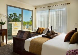 A bed or beds in a room at Anantara Vacation Club Legian