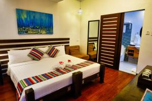 A bed or beds in a room at Hotel Soffia
