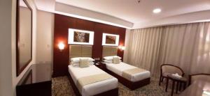 Cama ou camas em um quarto em فندق رفاف المشاعر