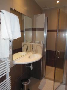 Salle de bains dans l'établissement Hotel Le Bellevue