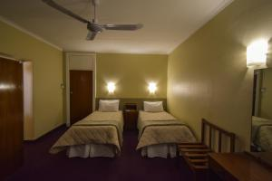 A bed or beds in a room at Park Hotel Bethlehem