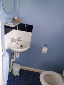 A bathroom at The Sands Hotel