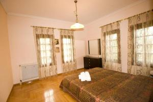A bed or beds in a room at Traditional Macedonian Mansion in Peraia