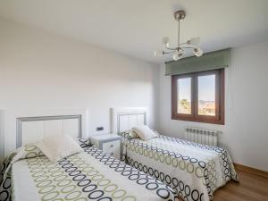 Cama o camas de una habitación en Modern Holiday home in A Coruna with Pool