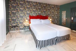 Un ou plusieurs lits dans un hébergement de l'établissement Petit Palace Puerta de Triana