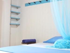 A bed or beds in a room at Folatún Rincón del Mar