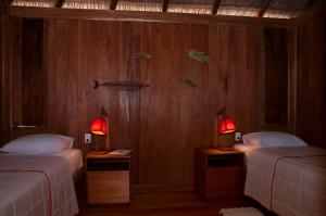 A bed or beds in a room at Jaguaribe Lodge e Kite