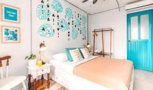 Cama o camas de una habitación en Selina La Fortuna