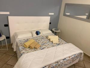 A bed or beds in a room at B&B ALDA