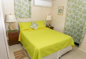 A bed or beds in a room at Banyan Beach House Villa
