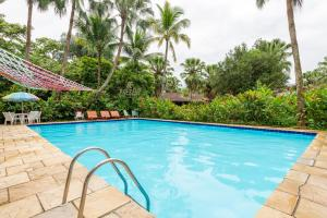 The swimming pool at or close to Selina Paraty