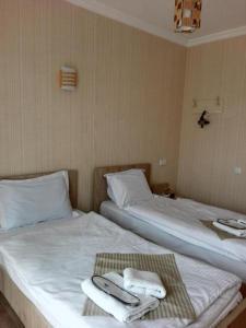 Кровать или кровати в номере Petre Palace