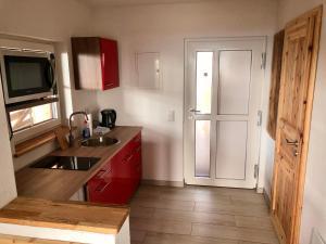Küche/Küchenzeile in der Unterkunft Gradlhof