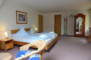Ein Bett oder Betten in einem Zimmer der Unterkunft Pension Bloo Tomato