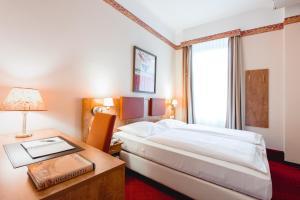 Кровать или кровати в номере Hotel Allegro Wien