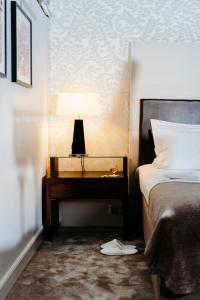 A bed or beds in a room at Elite Eden Park Hotel