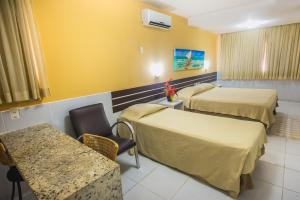 A bed or beds in a room at Hotel Pousada Tamandaré - PB