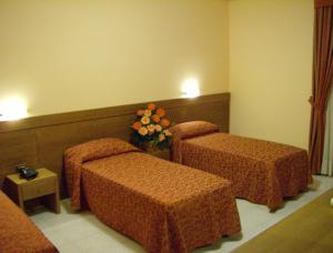 A bed or beds in a room at Hotel Zi Marianna