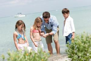 A family staying at South Seas Island Resort
