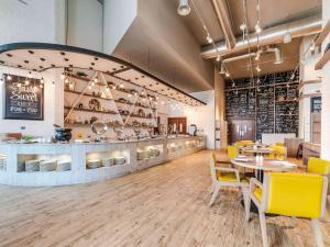 A restaurant or other place to eat at Ibis Styles Dragon Mart Dubai