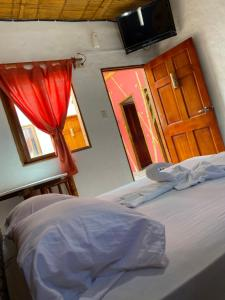A bed or beds in a room at Hotel Karukera