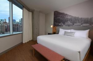A bed or beds in a room at Hotel Indigo Denver Downtown, an IHG Hotel