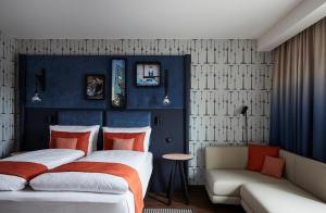 A bed or beds in a room at Hotel Indigo Berlin - East Side Gallery, an IHG Hotel