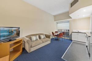 A television and/or entertainment center at YEHS Hotel Melbourne CBD
