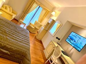 TV o dispositivi per l'intrattenimento presso Hotel Grillo