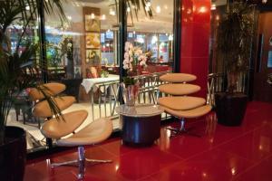 En restaurang eller annat matställe på Hotel Indigo London Tower Hill, an IHG Hotel